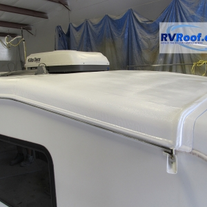 Finished front end cap of fifth wheel with lifetime no leak sprayed rv roof